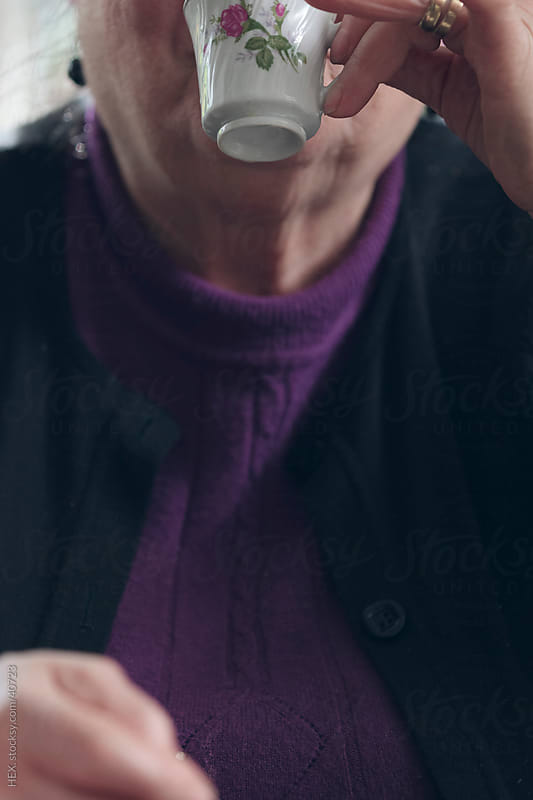 Italian Old Woman has coffee by HEX . for Stocksy United