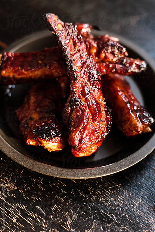 Sticky BBQ spare ribs. by Darren Muir for Stocksy United
