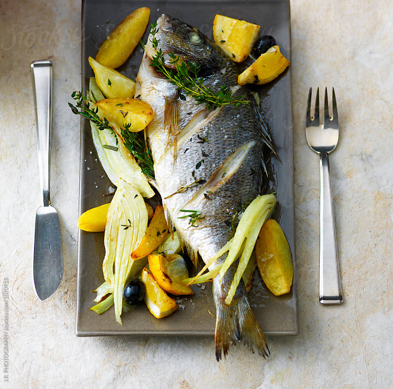 Sea Bream with potatoes and celery by J.R. PHOTOGRAPHY for Stocksy United