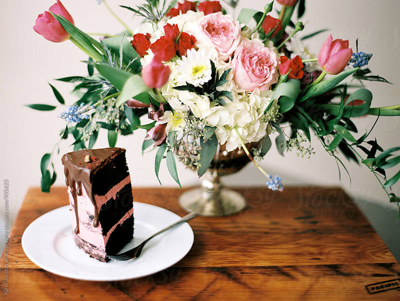 piece of cake with flowers by Kirill Bordon photography for Stocksy United