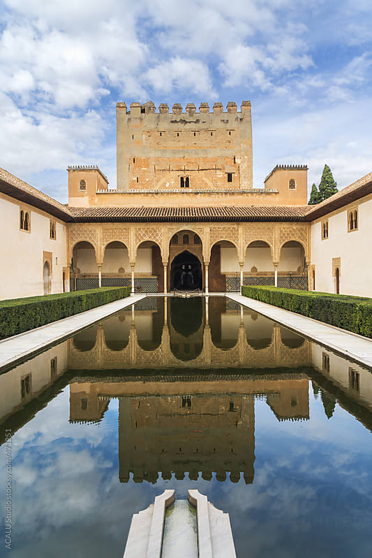 Comares tower reflected in the pond of the Court of the Myrtles by ACALU Studio for Stocksy United