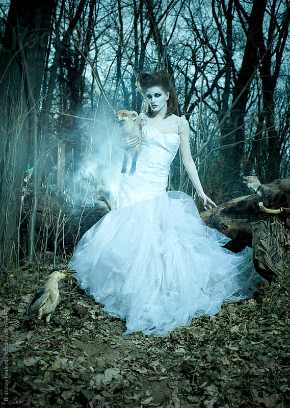 Fairy in white dress in blue forest by Bratislav Nadezdic for Stocksy United