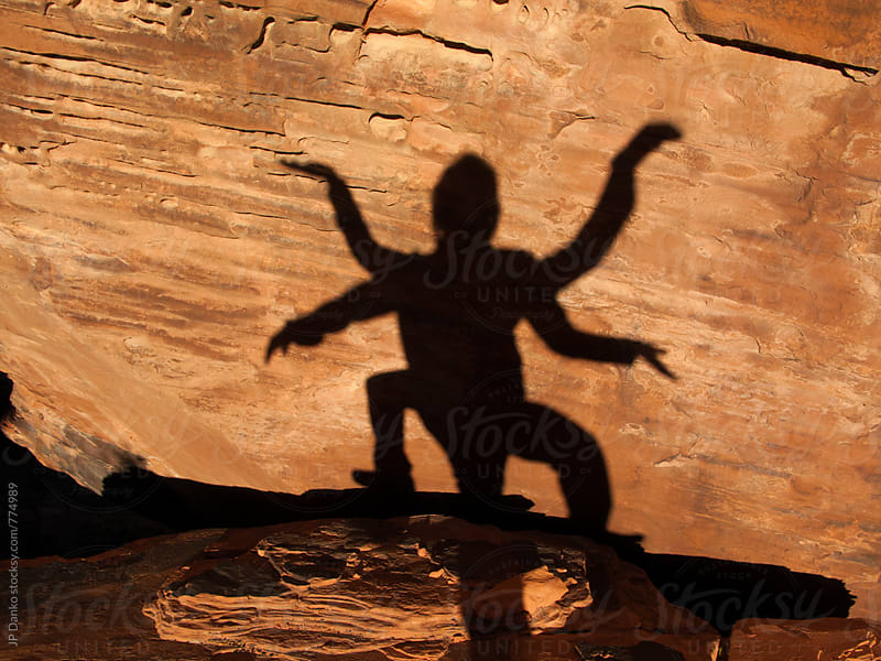 Humorous Shadows of Man and Woman Posing Together in Red Rock Canyon Las Vegas Nevada by JP Danko for Stocksy United