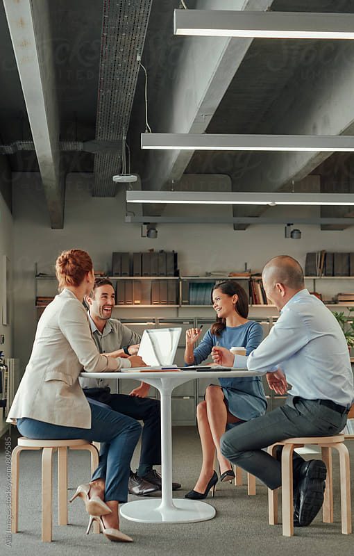 Informal business team meeting at lunch table by Aila Images for Stocksy United