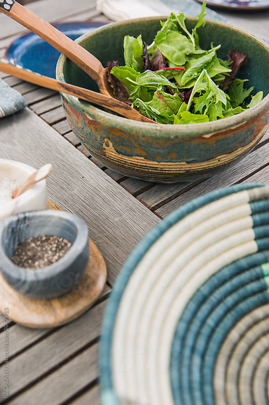 Salad and table setting outdoors. by Robert Zaleski for Stocksy United