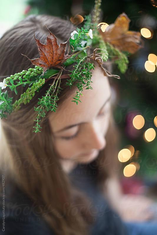 Teenage girl with a homemade wreath on her head by Carolyn Lagattuta for Stocksy United