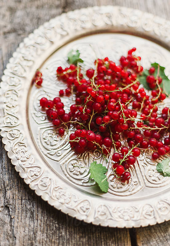 Red currant on a vintage plate by Natasa Kukic for Stocksy United