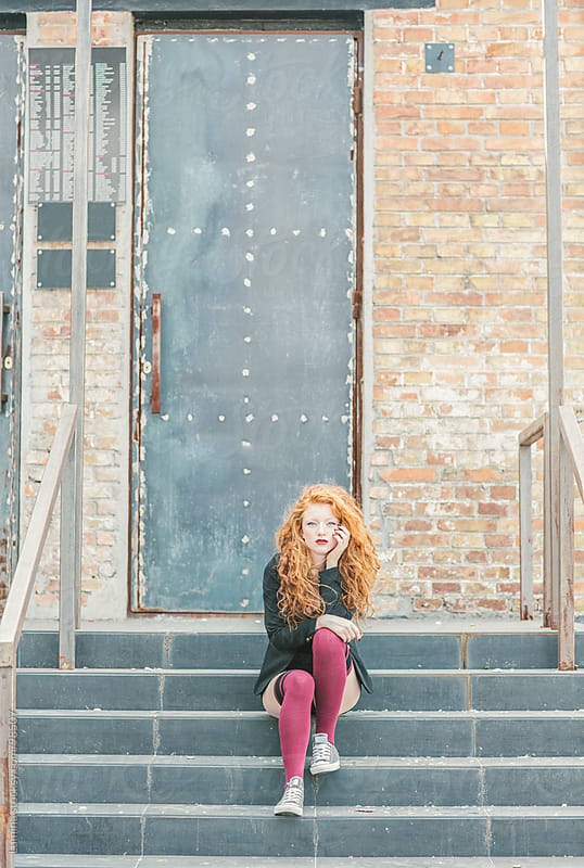 Ginger-Haired Woman Sitting on the Stairs by Lumina for Stocksy United