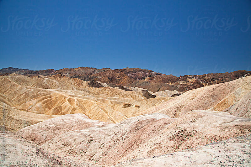 Zabriskie Point in Death Valley National Park in the heat of a summer's day by Natalie JEFFCOTT for Stocksy United