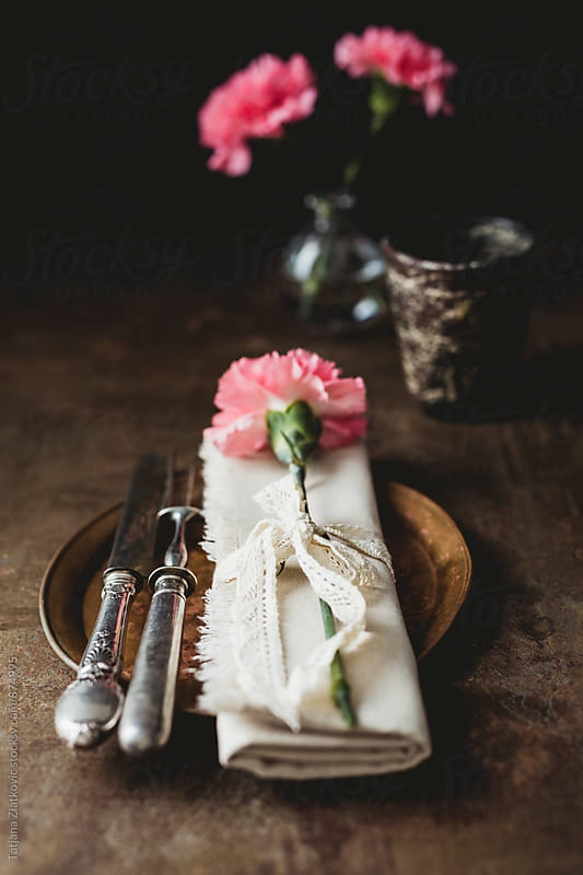 Place setting with carnation by Tatjana Zlatkovic for Stocksy United