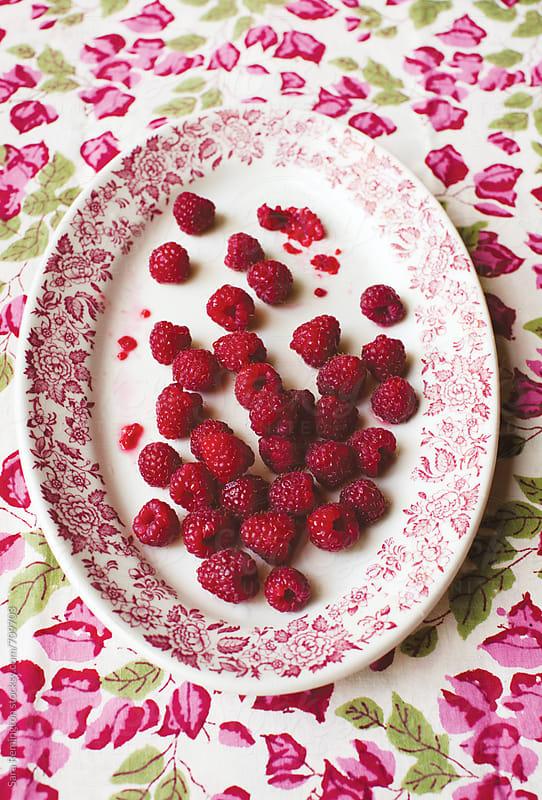 Raspberries on Platter by Sara Remington for Stocksy United
