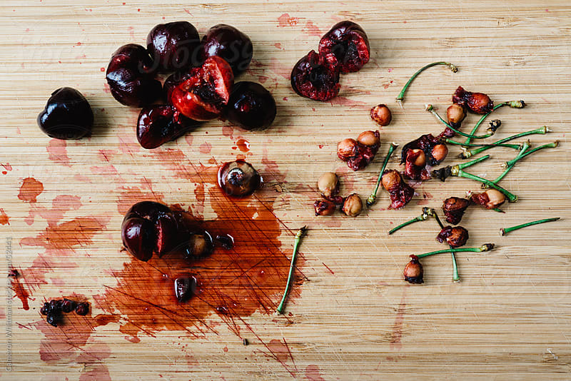 Pitting Cherries by Cameron Whitman for Stocksy United