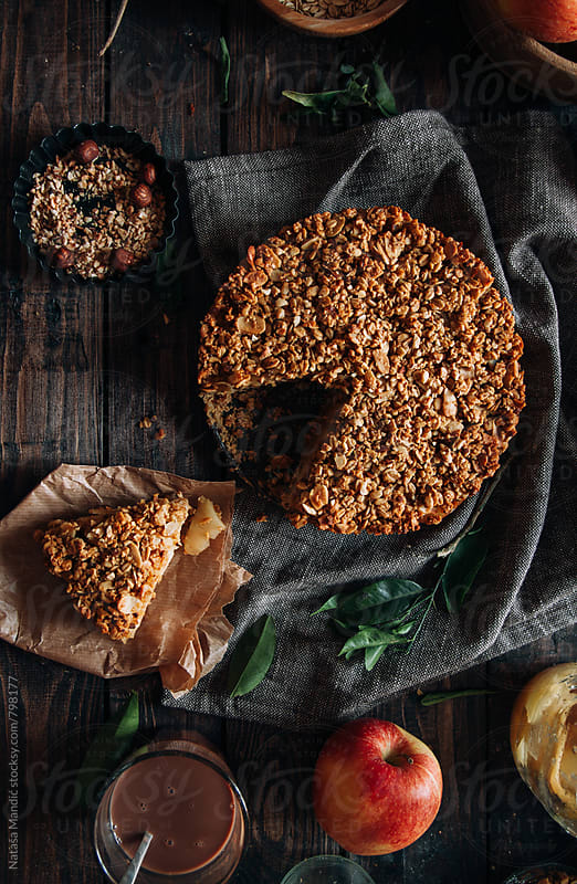 Homemade delicious crumble apple pie by Nataša Mandić for Stocksy United