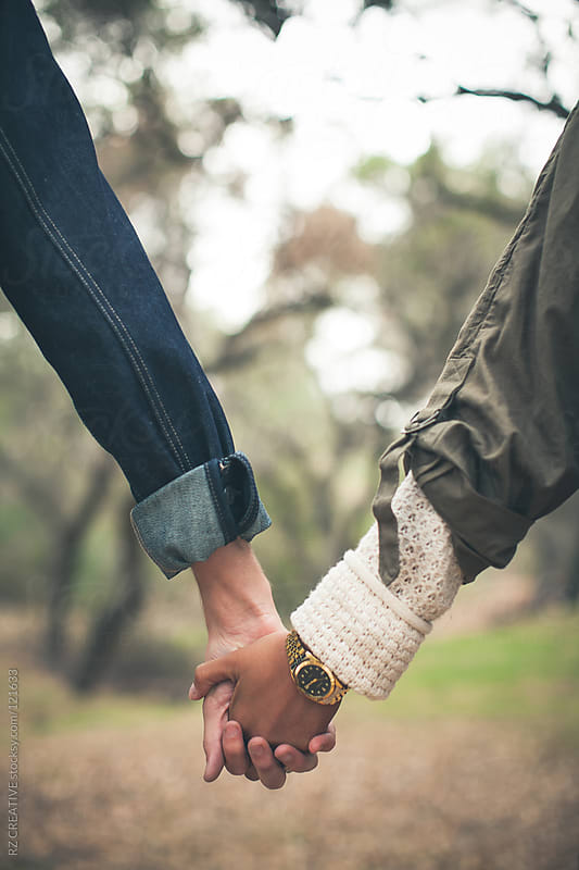 Young couple holding hands outdoors. by RZ CREATIVE for Stocksy United