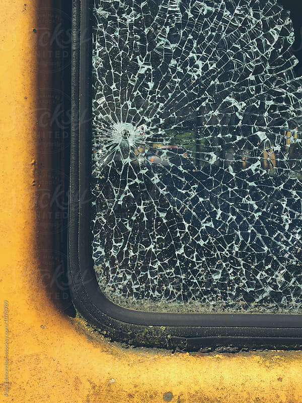 Detail of car door and shattered window by Paul Edmondson for Stocksy United