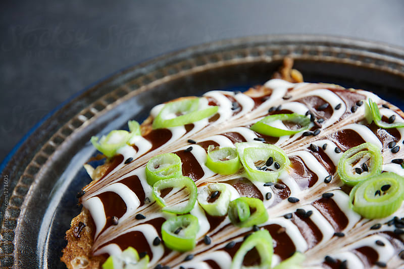Okonomiyaki - Japanese Cabbage Pacakes by Harald Walker for Stocksy United