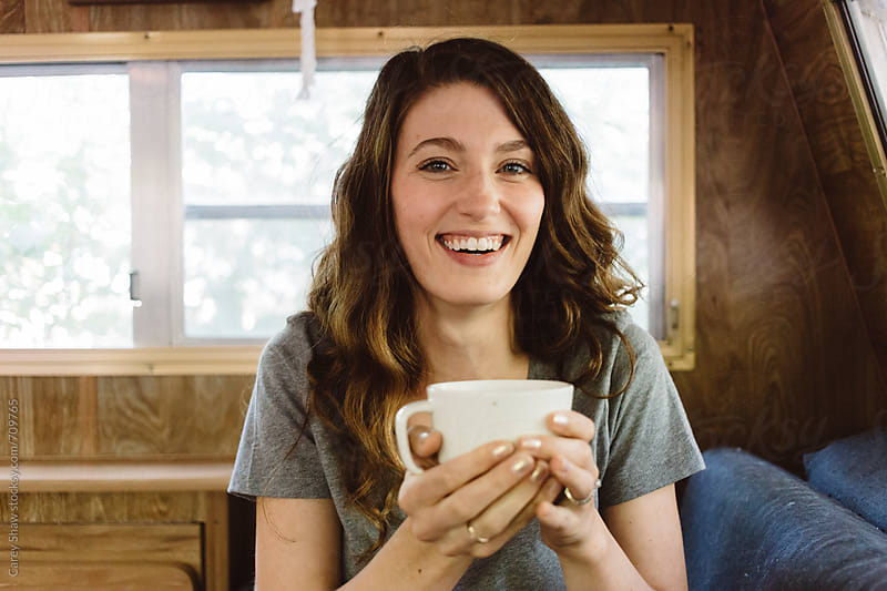 Attractive brunette drinking coffee by Carey Shaw for Stocksy United