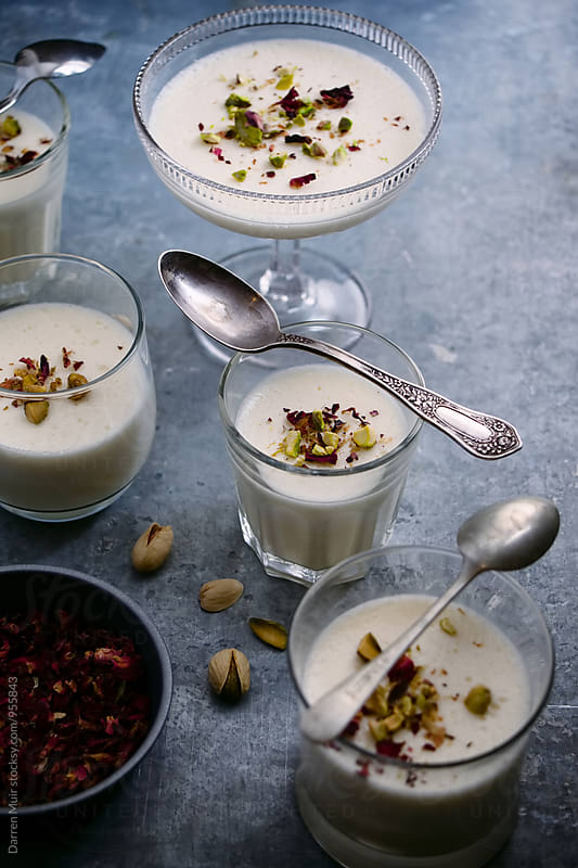 Panna cotta: Rose petal and pistachio panna cotta. by Darren Muir for Stocksy United