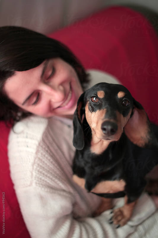 Portrait of a cute dachshund and a beautiful girl  by VeaVea for Stocksy United