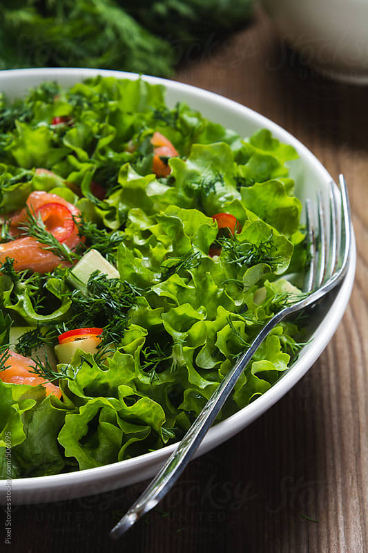 Food: healthy lettuce salad with smoked salmon by Pixel Stories for Stocksy United