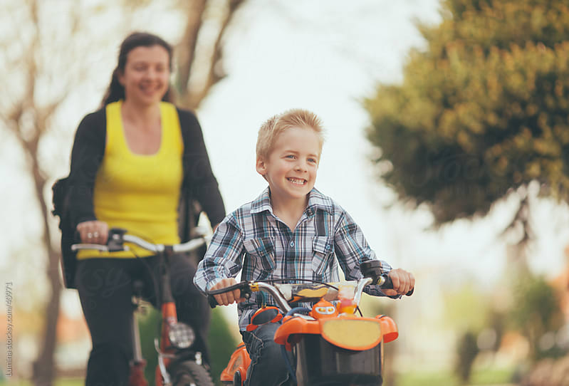 Mother and Son Riding Bicycles by Lumina for Stocksy United