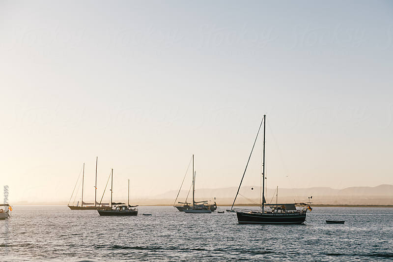 Boats at Sunset by Agencia for Stocksy United