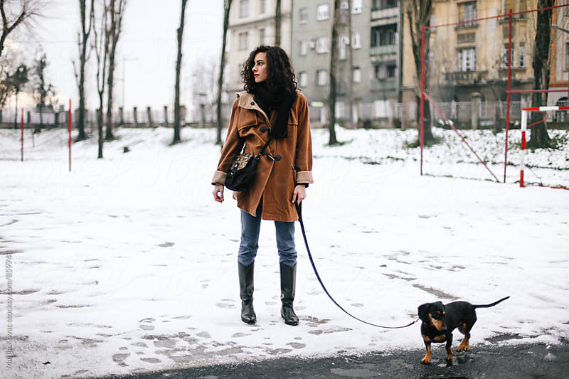 Brunette woman with her black dachshund by Marija Kovac for Stocksy United