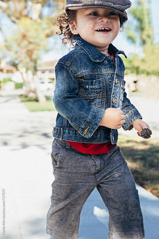 Adorable little boy running and smiling by Curtis Kim for Stocksy United