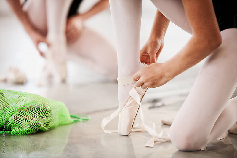 Ballet: Student Putting on Pointe Shoes by Sean Locke for Stocksy United