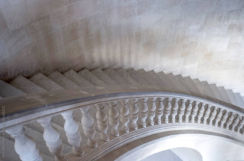 Sweeping curve of a stone stair case. by Mike Marlowe for Stocksy United