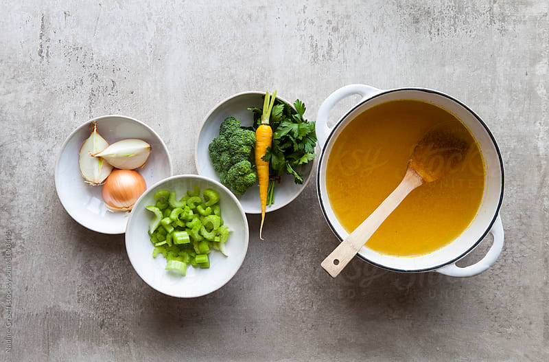Vegetable stock with chopped vegetable ingredients by Nadine Greeff for Stocksy United