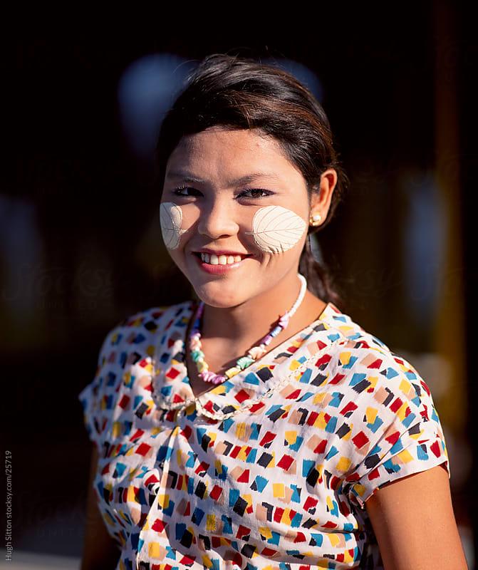Portrait of smiling Burmese girl wearing thanaka on her face. Myanmar. by Hugh Sitton for Stocksy United