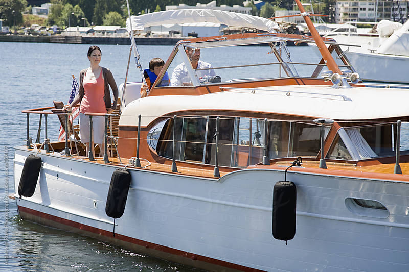 Family with son (8-9) on yacht by Andersen Ross Photography for Stocksy United