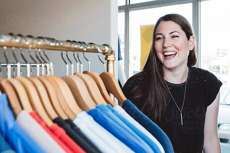 Happy entrepreneur in her clothing boutique by Carey Shaw for Stocksy United