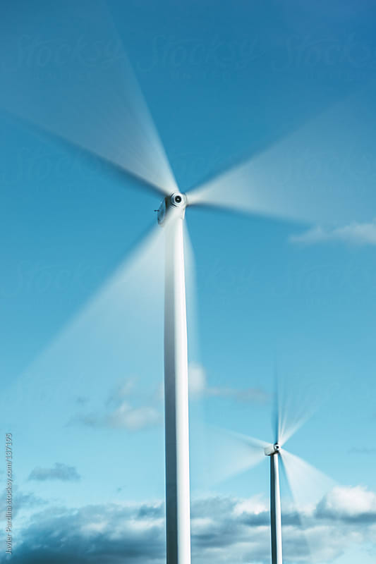 Wind Turbines on the rural area. by Javier Pardina for Stocksy United