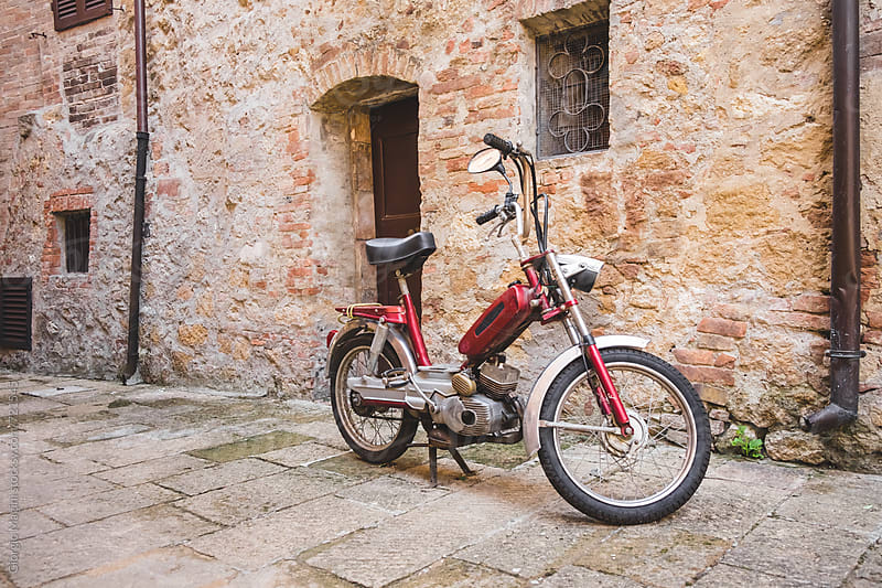 Vintage Motorcycle in Small Village Alley by Giorgio Magini for Stocksy United