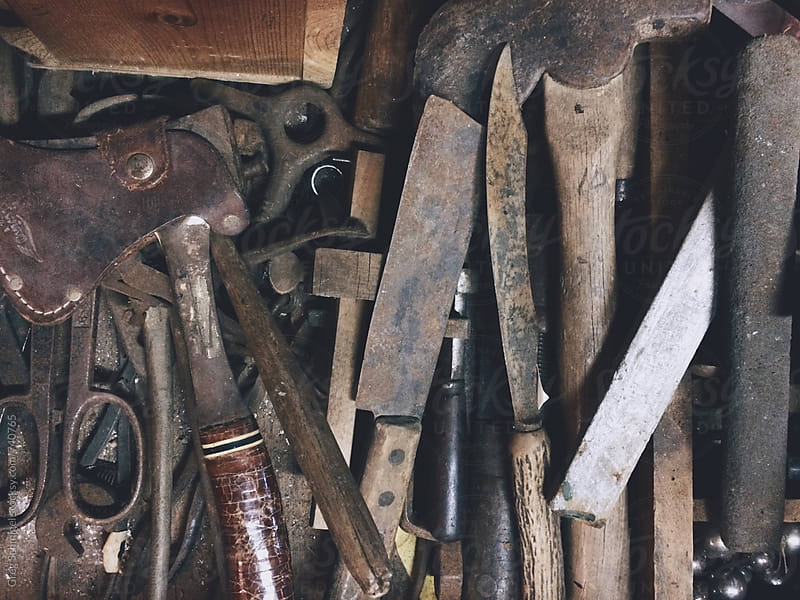 Old rusty metal tools on a workbench by Greg Schmigel for Stocksy United