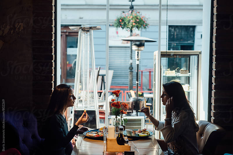 Women having a breakfast in the restaurant by Boris Jovanovic for Stocksy United