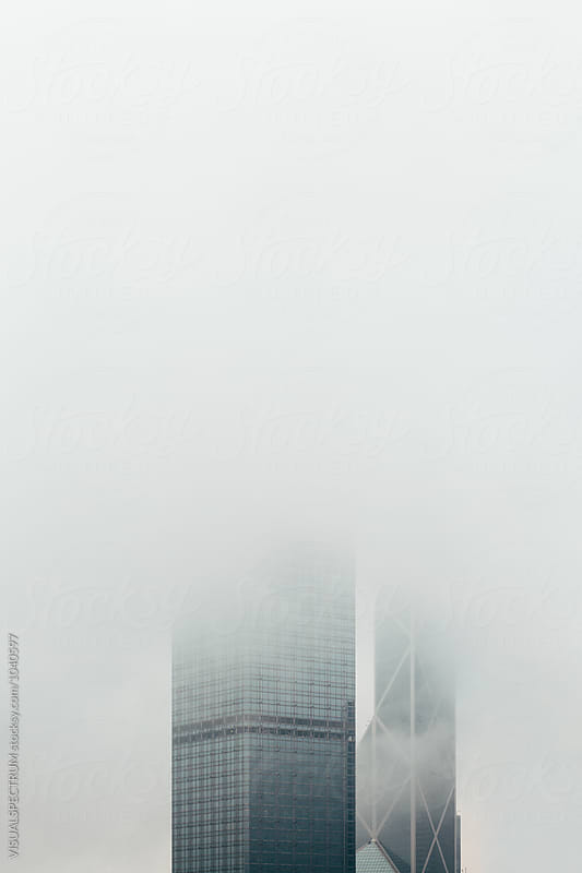Hong Kong Skyscraper Disappearing in Fog by Julien L. Balmer for Stocksy United