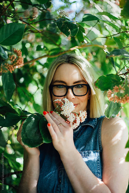 Stopping to smell the flowers by Kara Riley for Stocksy United