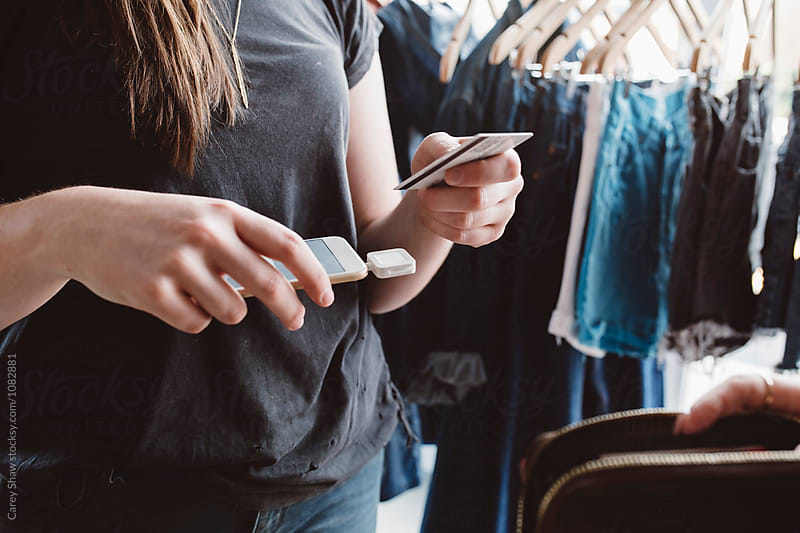 Making purchase using mobile phone by Carey Shaw for Stocksy United