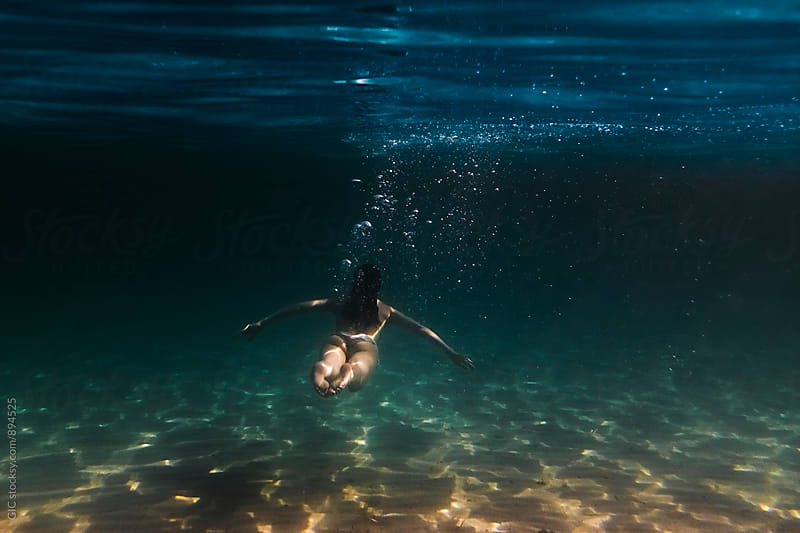 Young woman underwater by GIC for Stocksy United