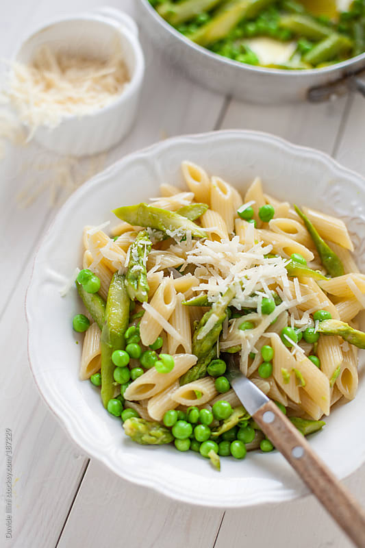Pasta with asparagus and peas by Davide Illini for Stocksy United