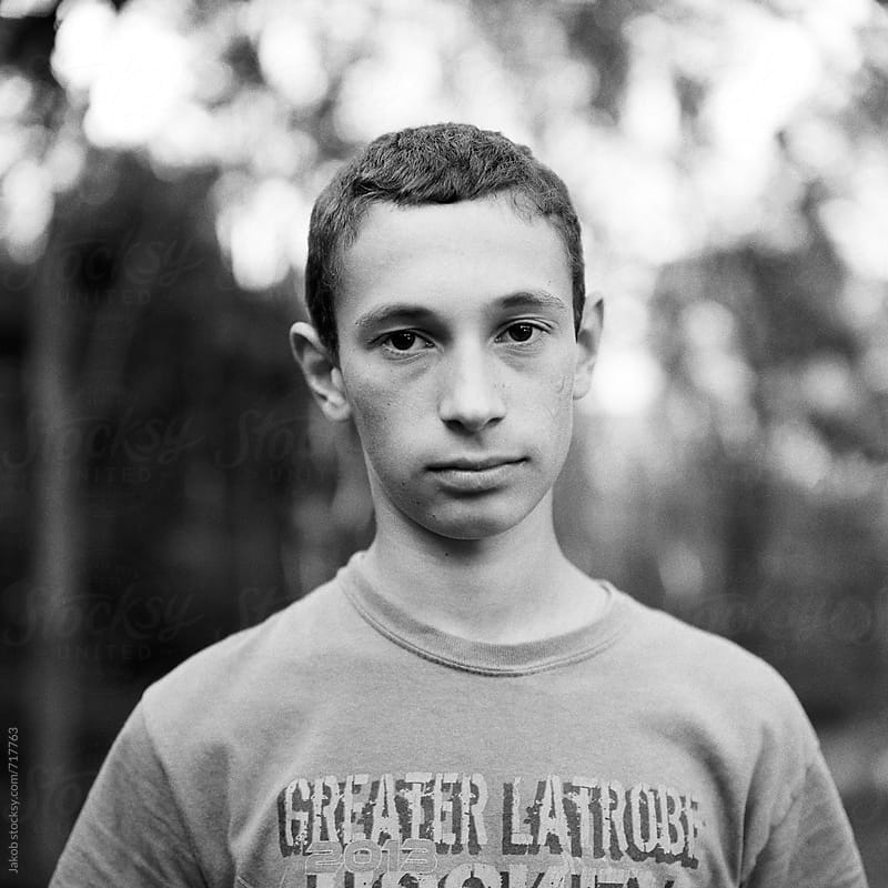 Black and white portrait of a young man by Jakob for Stocksy United