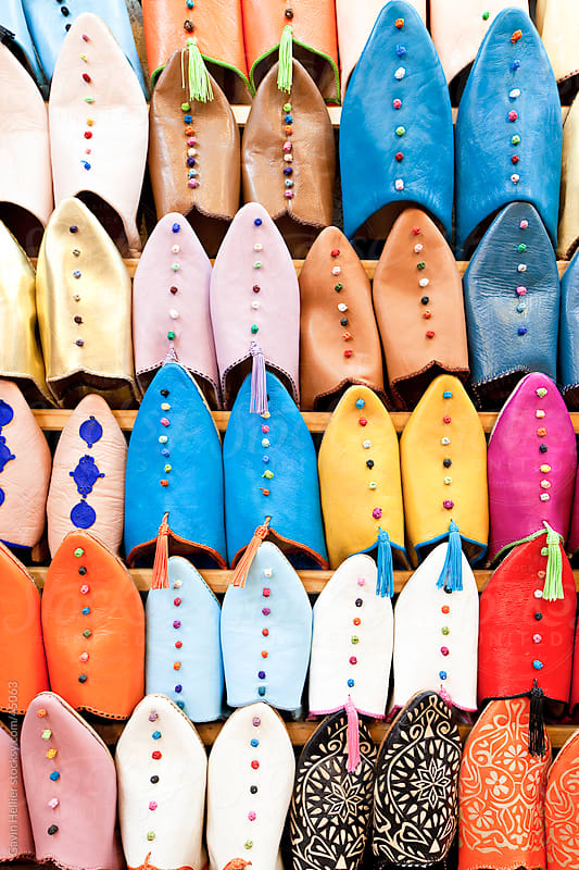 Soft leather Moroccan slippers in the Souk, Medina, Marrakesh, Morocco, North Africa by Gavin Hellier for Stocksy United