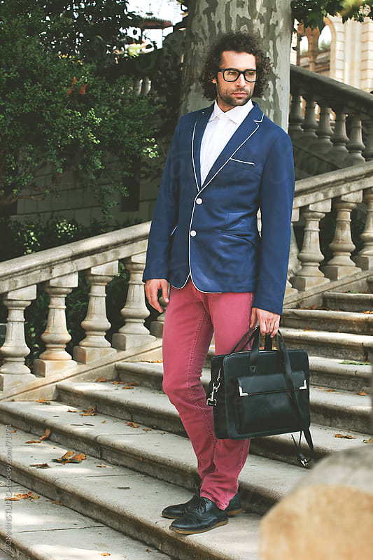 Style businessman with briefcase standing on a city park. by BONNINSTUDIO for Stocksy United