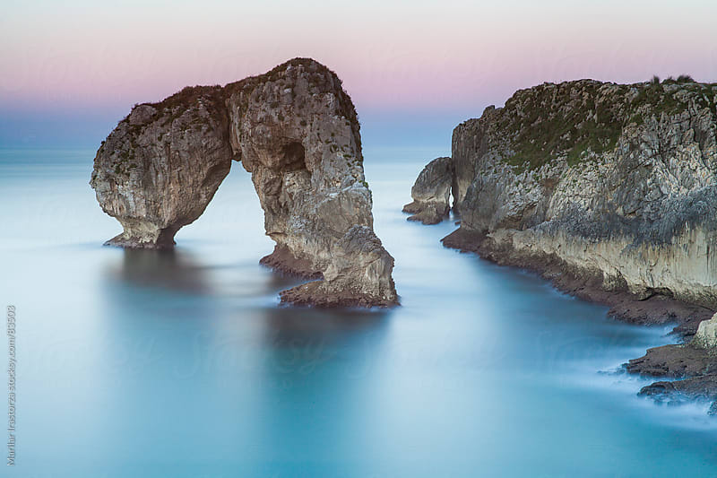 Vagaries of Nature - Beautiful arch in the sea by Marilar Irastorza for Stocksy United