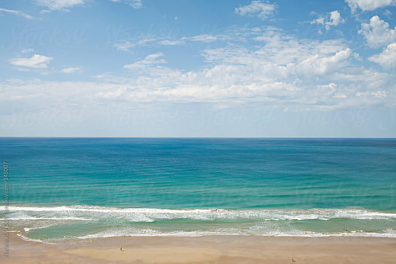 wide view of the beach in Summer along the Great Ocean Road in Victoria Australia by Natalie JEFFCOTT for Stocksy United
