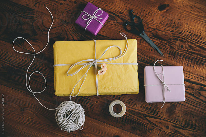 Presents, scissor, twine and tape from above by Lior + Lone for Stocksy United