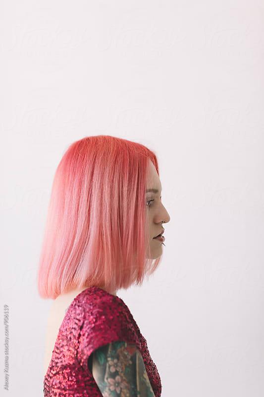 young woman with pink hair by Alexey Kuzma for Stocksy United